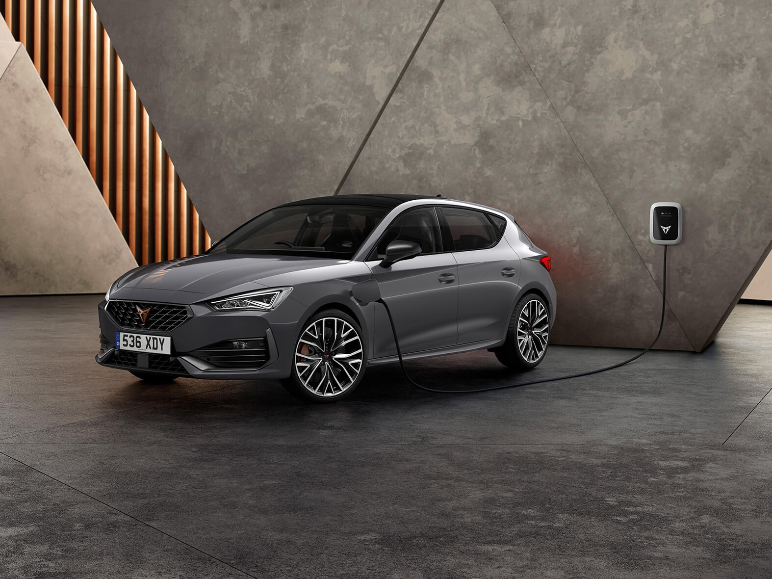 new CUPRA Leon ehybrid five door magnetic tech matte compact sports car front side view charging